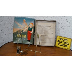 Vintage Single Bar Exercise wind-up toy. Eat this Epke